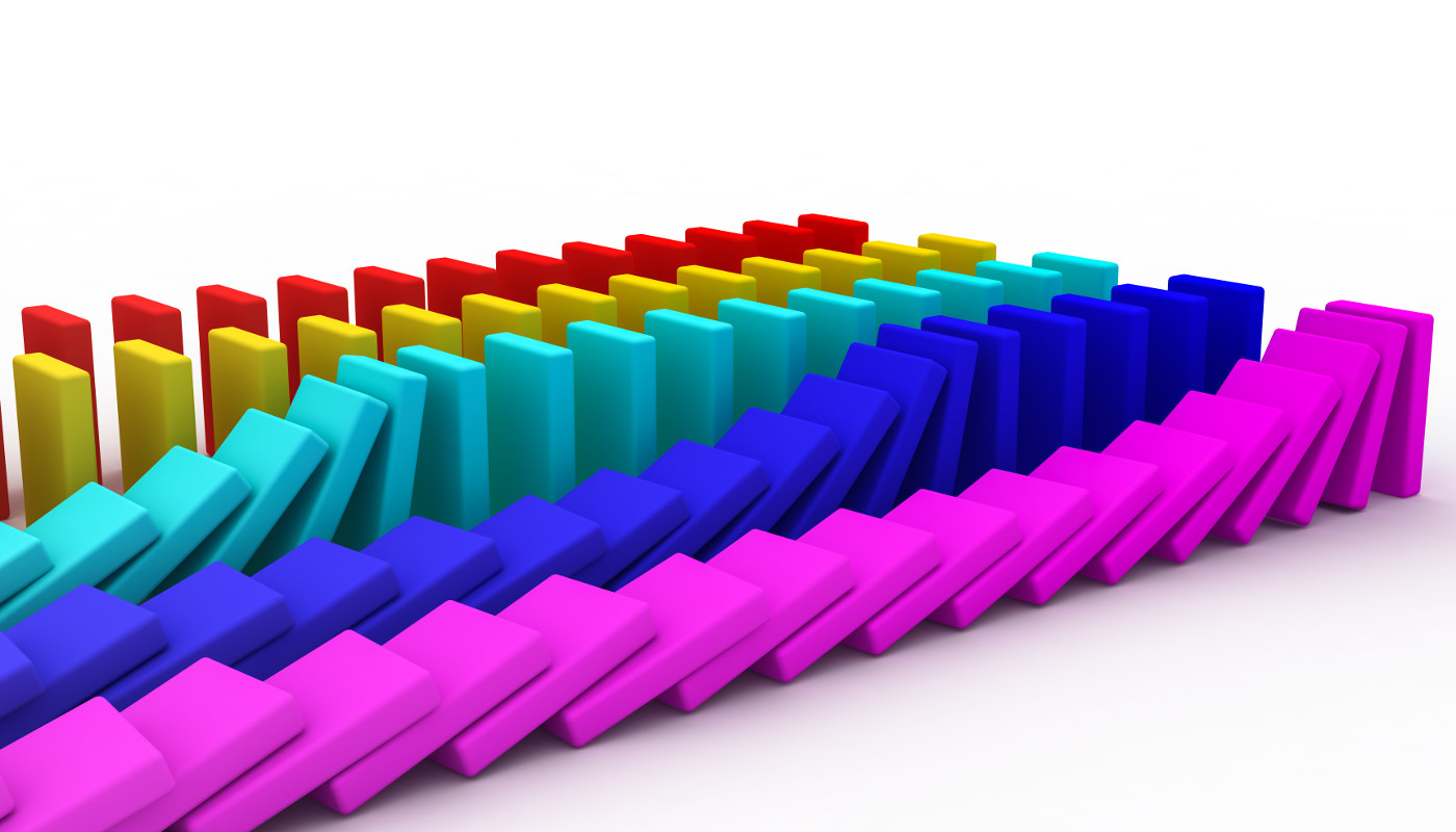 Colorful parallel rows of dominos, triggering controlled chain reactions.